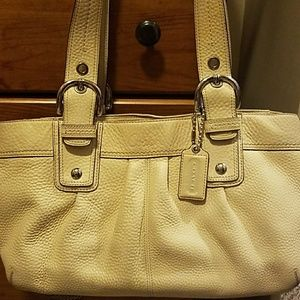 Ivory coach purse.  It's the perfect size.